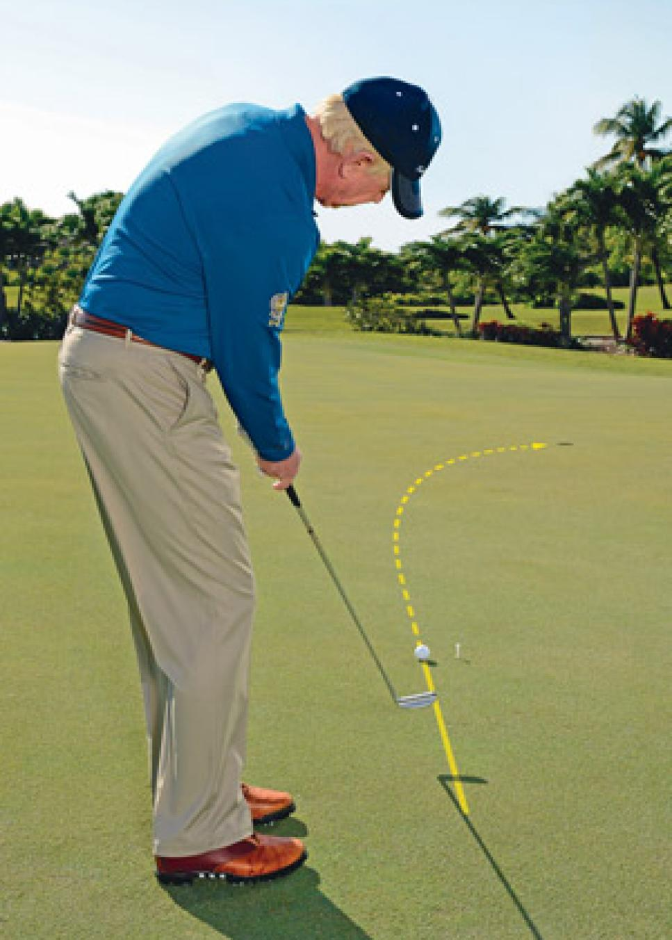 instruction-2013-10-inar01-jim-mclean-breaking-putt.jpg
