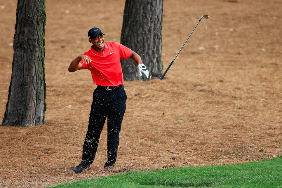 tiger-woods-masters-2015-wrist-injury.jpg