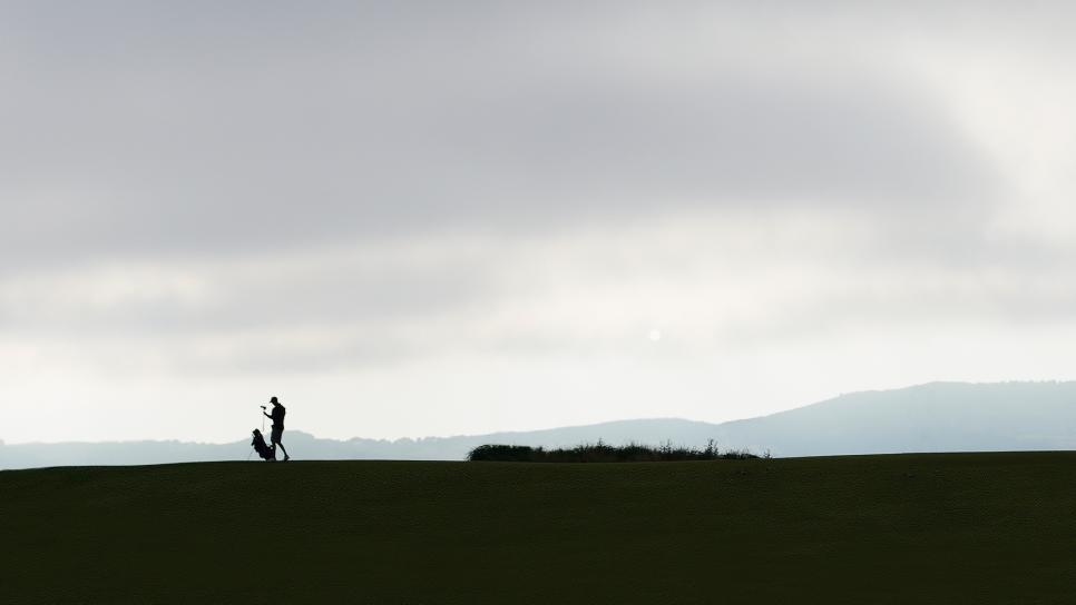 editors-letter-silhouetted-golfer-staff.jpg