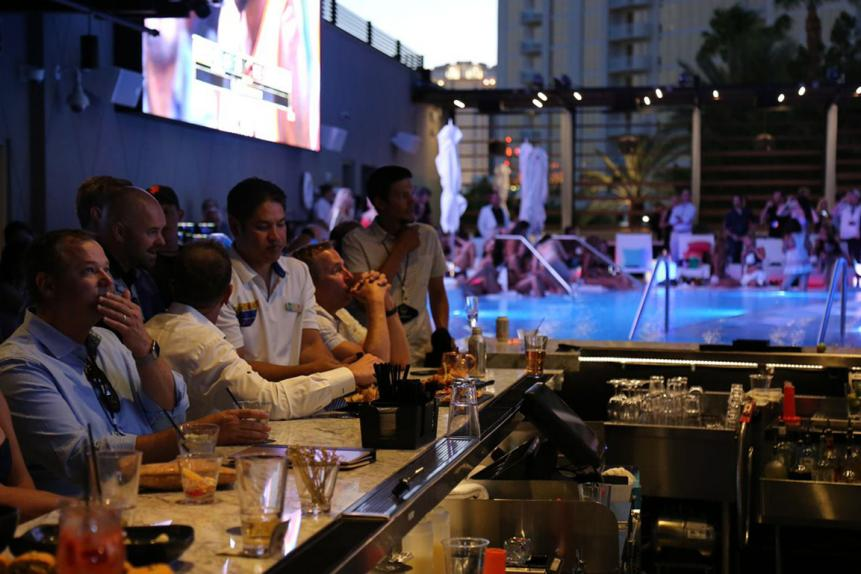 The pool on the third floor runs right up to this bar, which is one of the venue's five full-service bars.