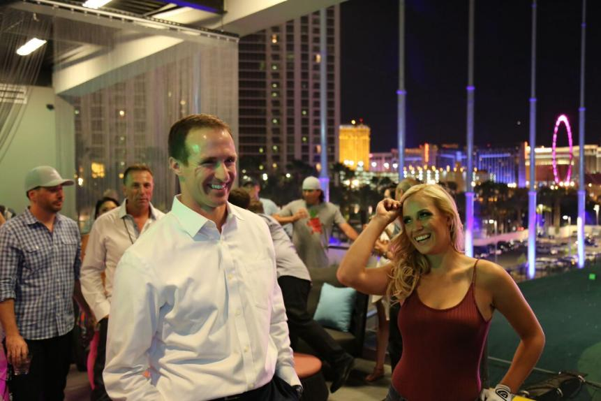 The grand-opening party attracted stars like Drew Brees, who lost to Paige in a one-on-one range duel.
