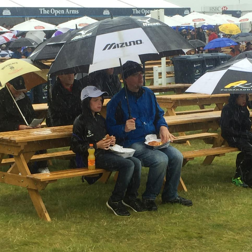 royal-troon-spectators-eating-in-rain.jpg