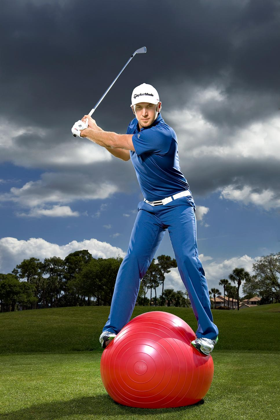 Dustin Johnson standing on stability ball