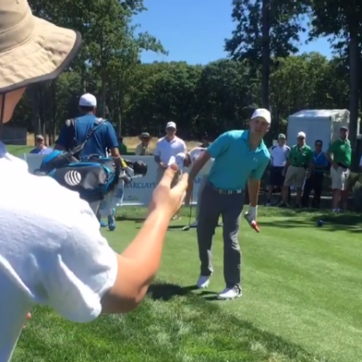 Watch Jordan Spieth sign a Budweiser bottle for a fan at the Barclays