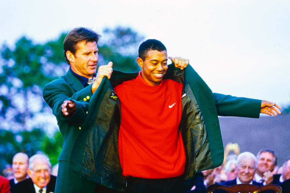 97masters-revisited-tiger-getting-green-jacket-faldo.jpg