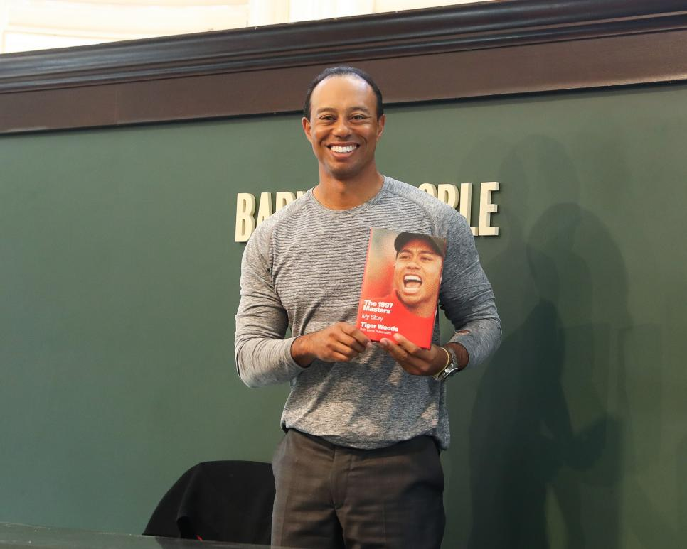 "Tiger Woods Signs Copies Of His New Book ""The 1997 Masters: My Story"""
