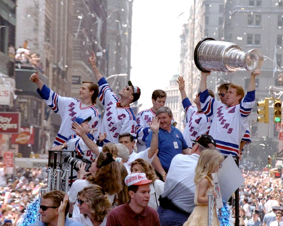Adam Graves (far left) and Captain Mark Messier (sunglasses)