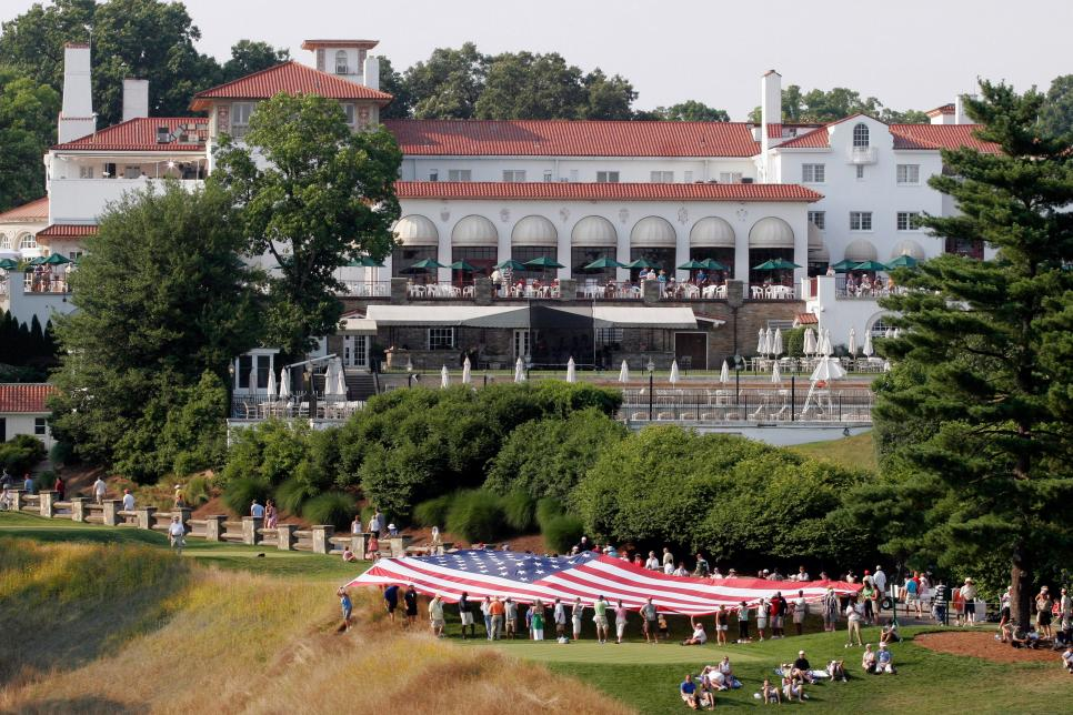 An American flag is unfurled near the clubhouse during the f