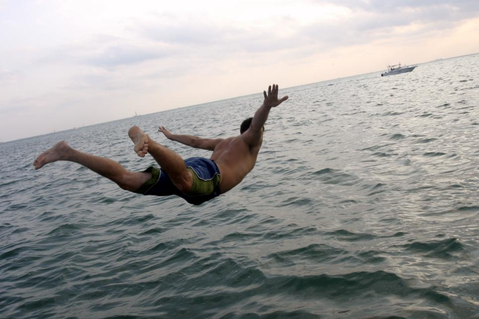 man diving in ocean