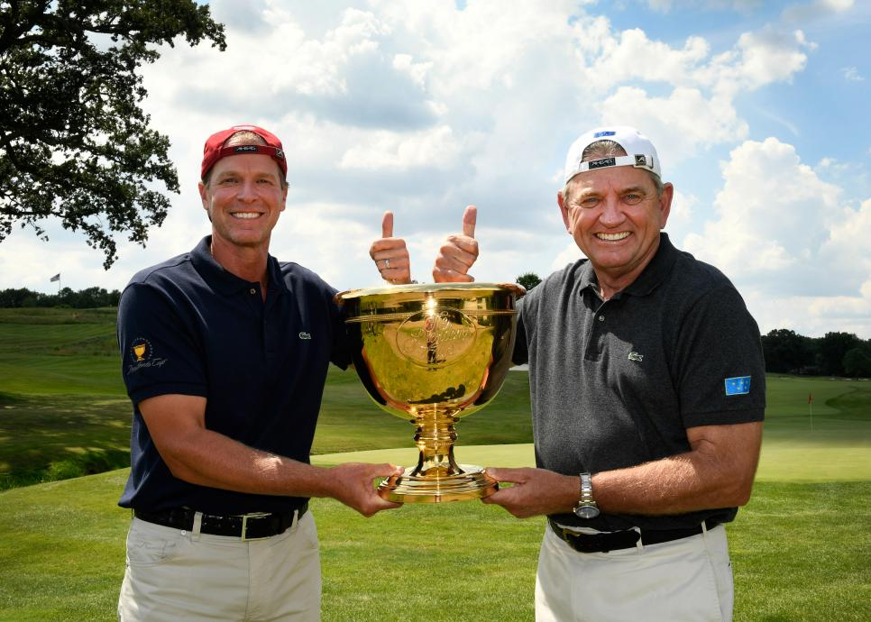 steve-stricker-nick-price-presidents-cup-hats-backward.jpg