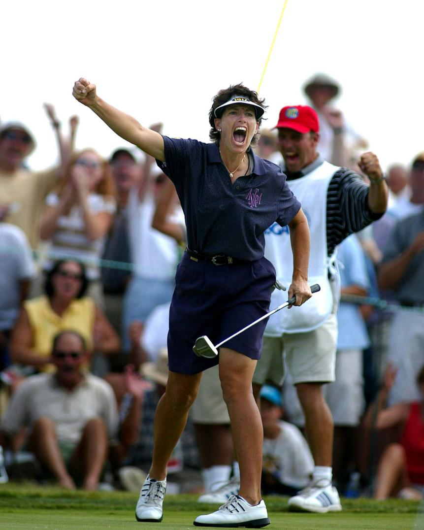 Julie Inkster celebrates her birdie putt on number