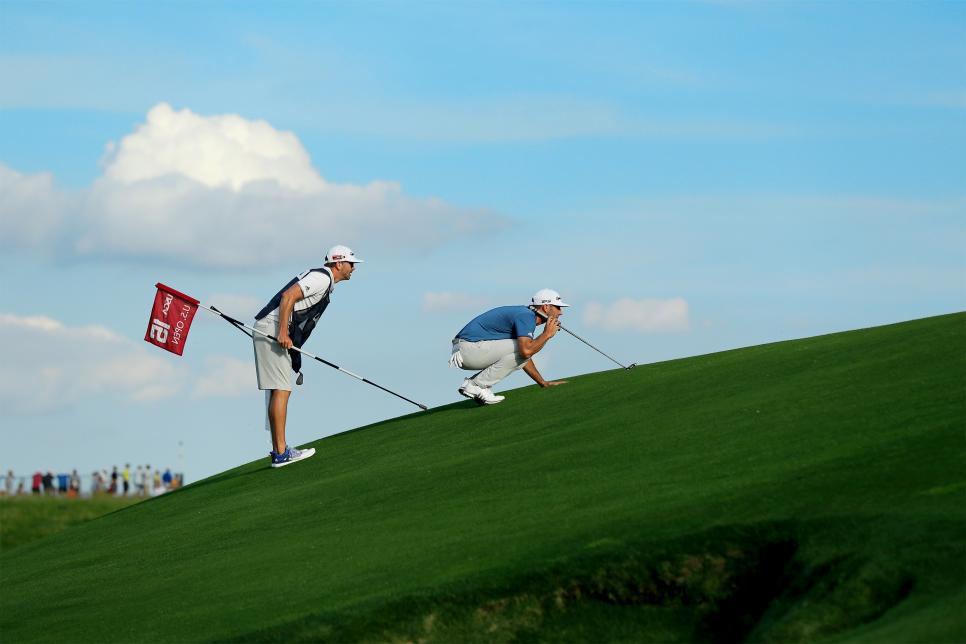 Dustin-Johnson-practice-lining-up-putt.jpg
