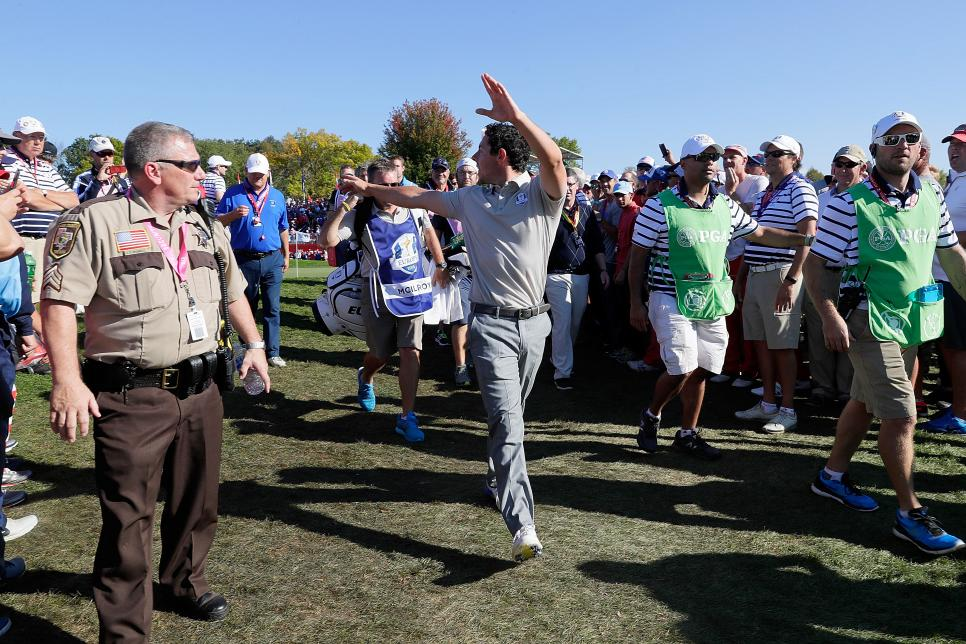 rory-mcilroy-ryder-cup-2016-kicking-fan-out.jpg
