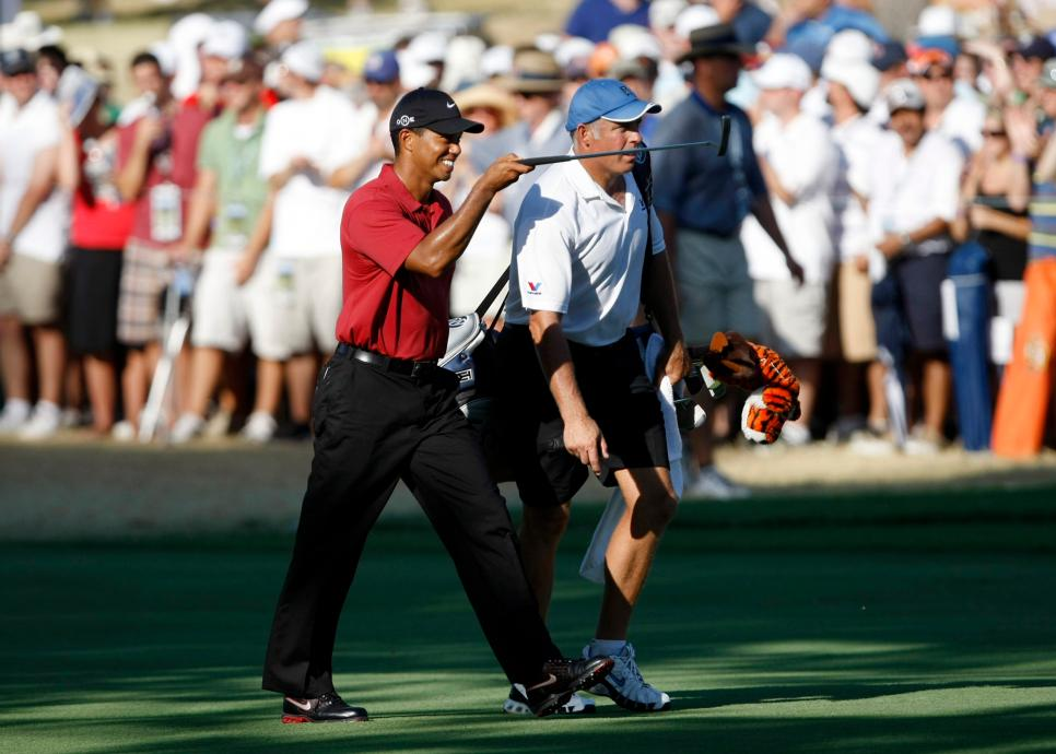 Tiger Woods, along with caddy Steve Williams, points to the