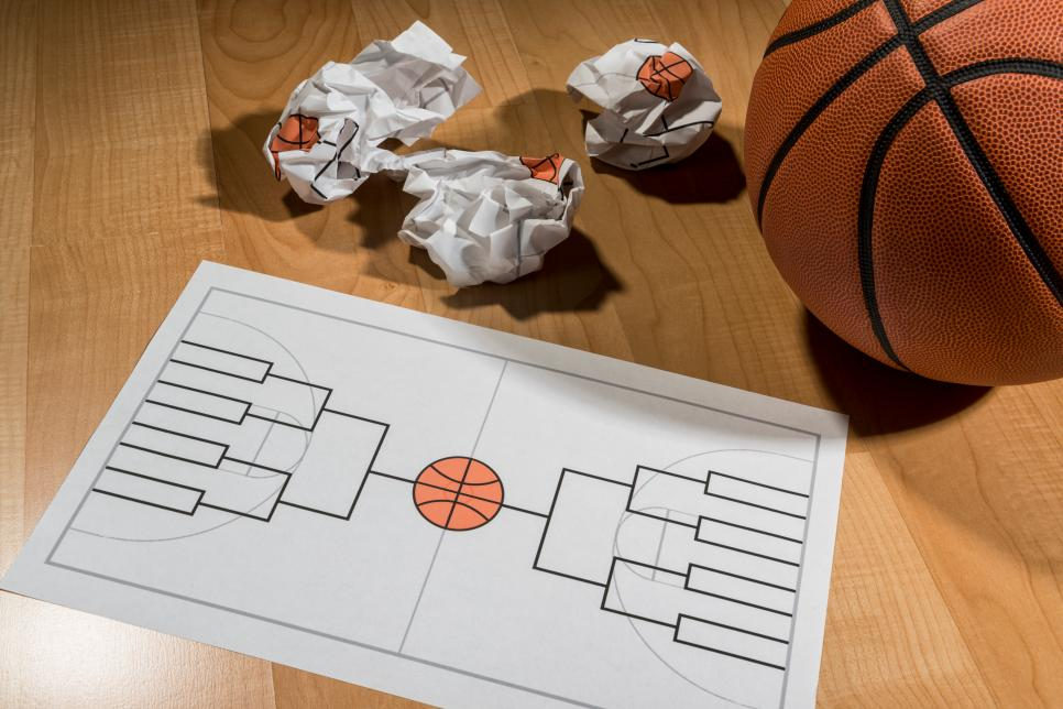 Trying to fill out college basketball tournament bracket on paper