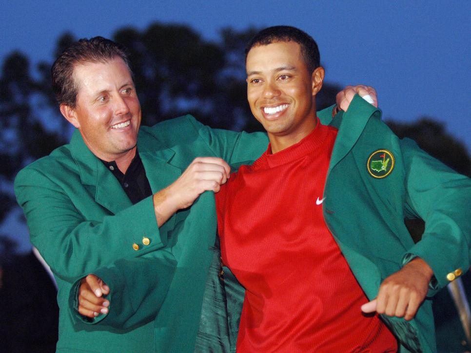 US golfer Tiger Woods (R) is awarded his