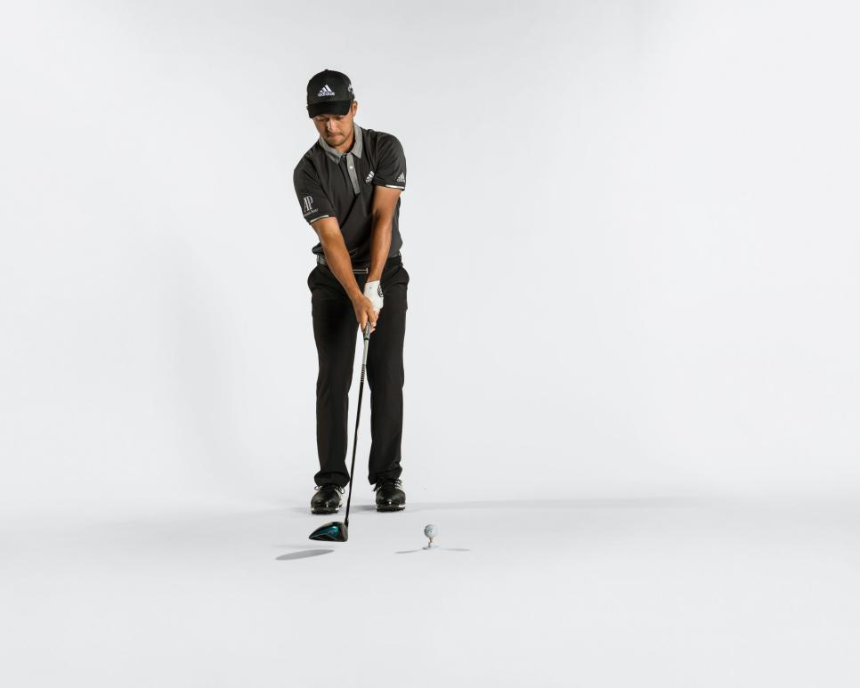 xander-schauffele-instruction-may-2018-stepping-to-address.jpg