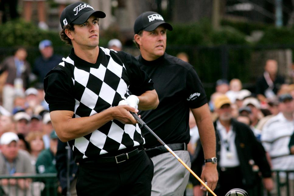 Golfers Adam Scott, left, and Phil Mickelson follow Scott's