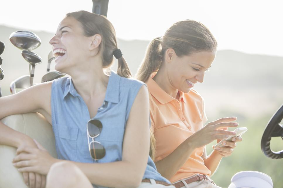 Women sitting in golf cart