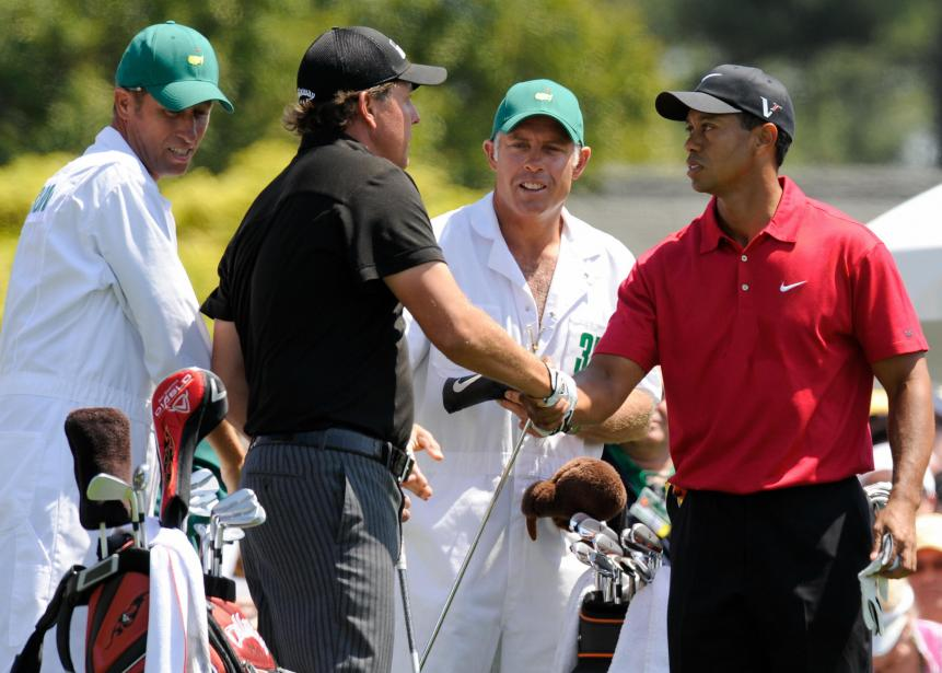 US golfers Phil Mickelson (2nd L) and Ti