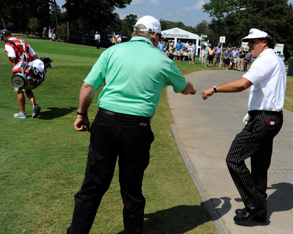 johnny-miller-phil-mickelson-fist-bump-2012-tour-championship.jpg