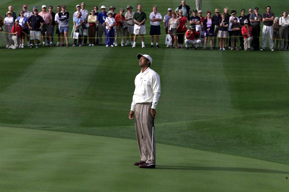 Tiger Woods of the US reacts on the fourth green d