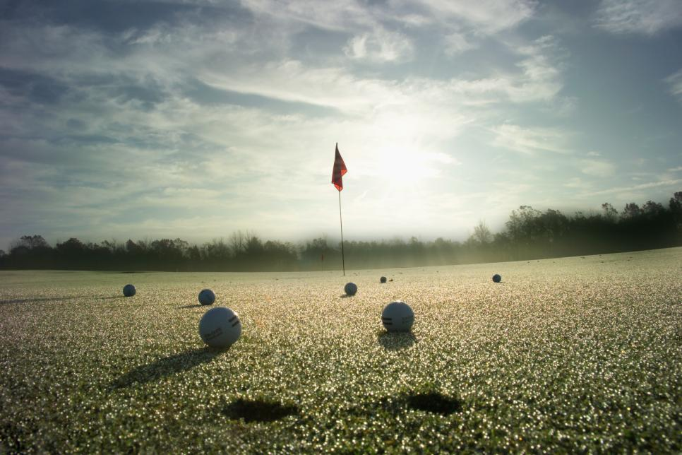 Driving range with ice crystals melting in morning sun (wide angle)