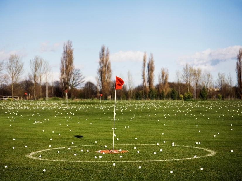 Golf flagstick on driving range