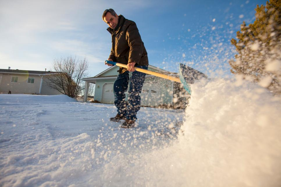 A man shovels snow off his driveway in northern Alberta.