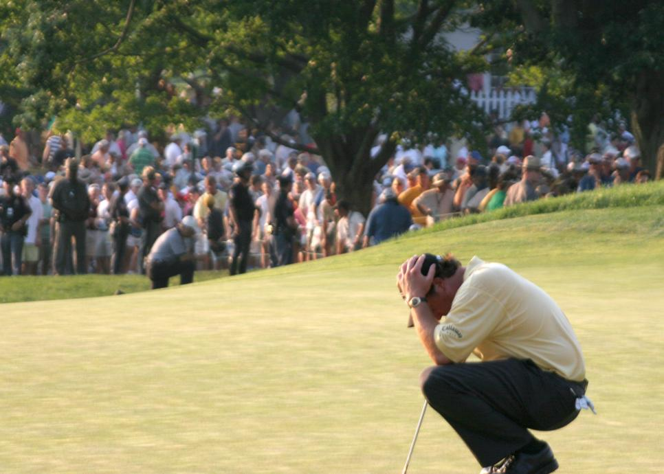 Golfer Phil Mickelson holds his head in his hands June 18, 2