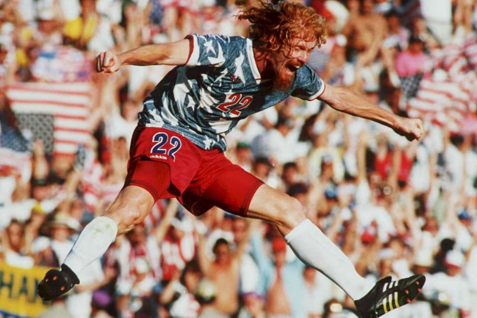US national team defender Alexi Lalas jumps in the
