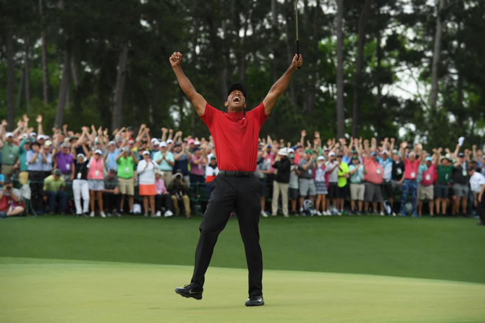 newsmakers-2019-final-lead-tiger-woods-masters-jd-cuban-celebration.jpg
