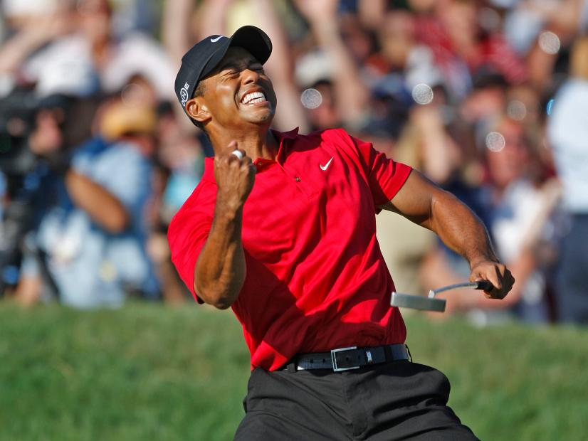 Tiger Woods reacts as he sinks a birdie putt on the 18th hole to force a playoff with Rocco Mediate