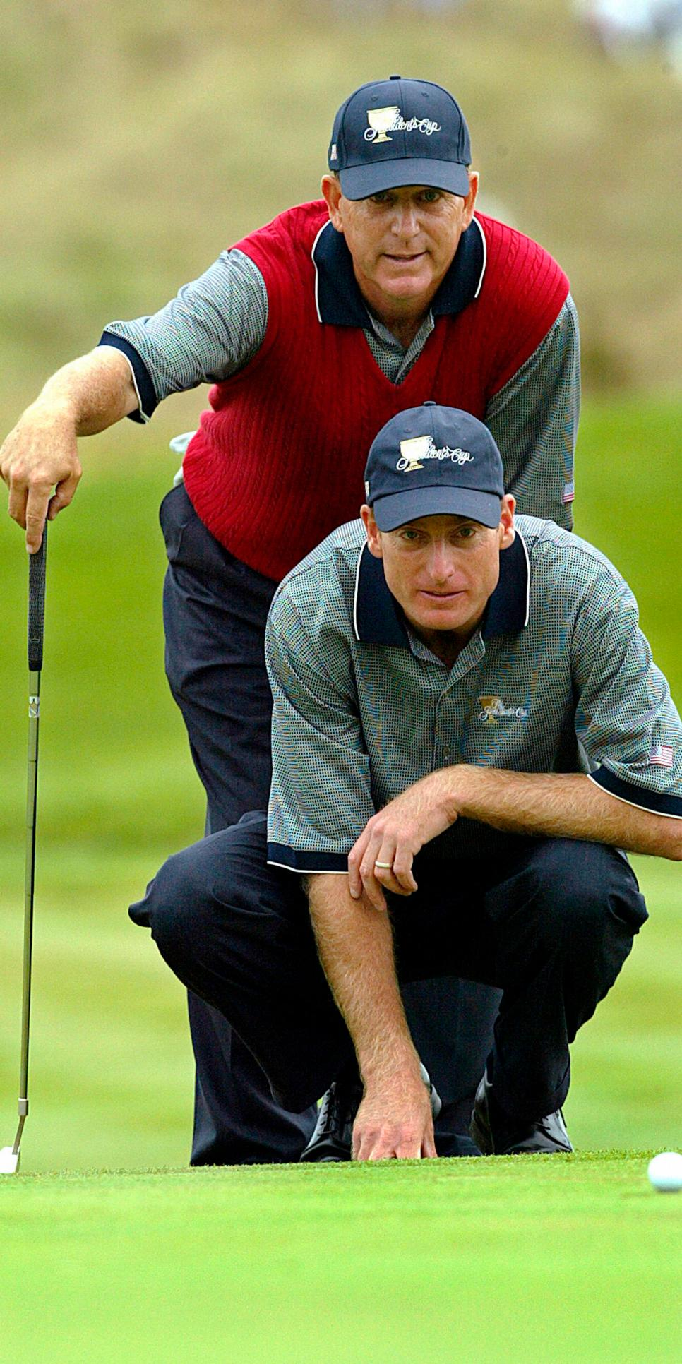 Jim Furyk down and Jay Hass of the US li