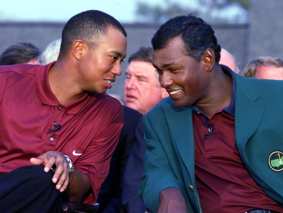 Tiger Woods (L) of the US shares a laugh with 2000