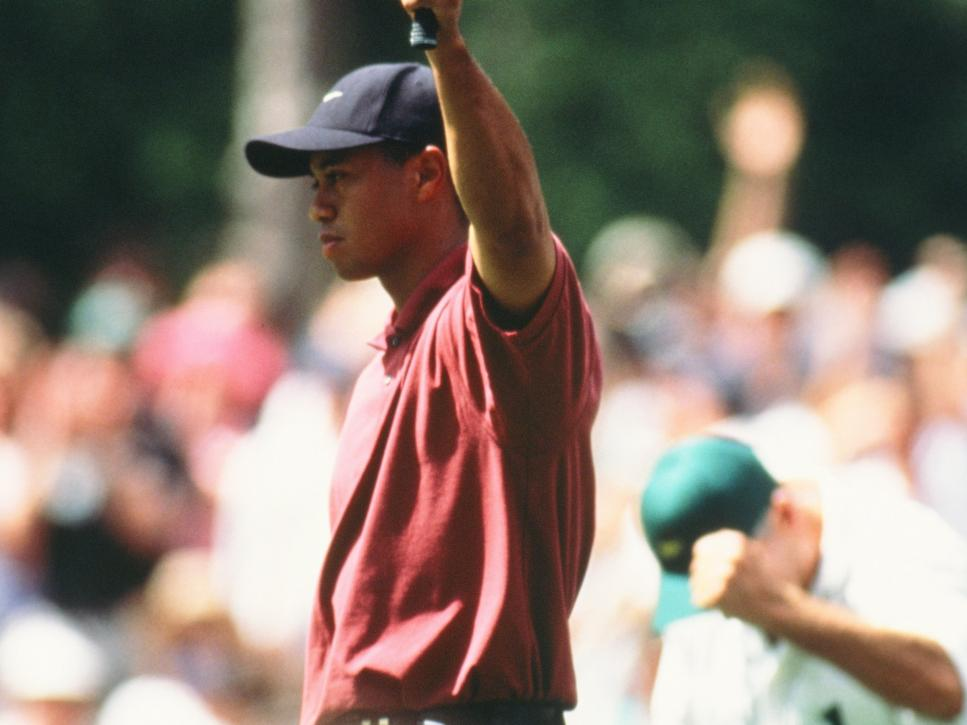 Tiger Woods Celebrates His Putt During The 2002 Masters Tournament