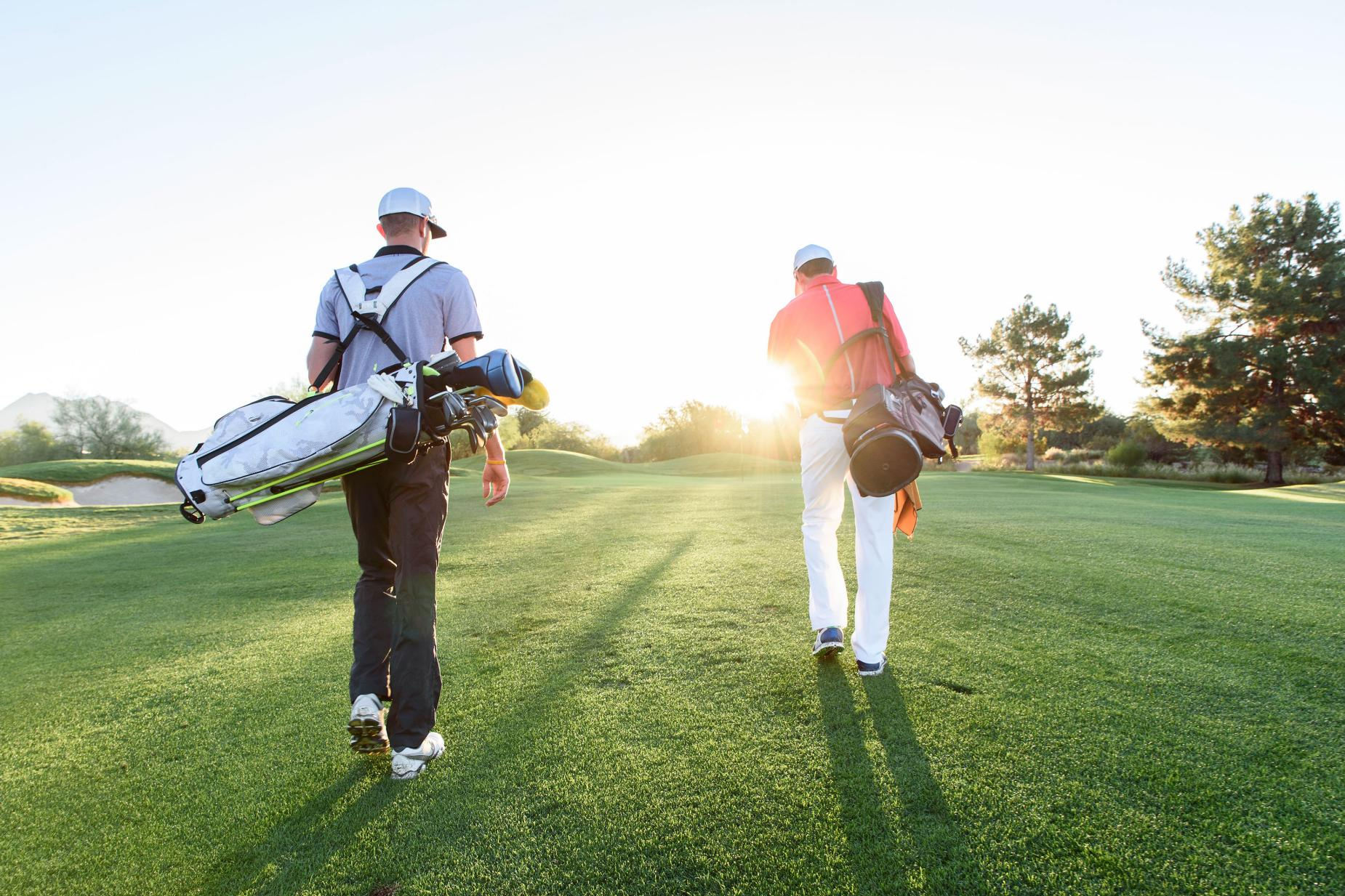 golfers-playing-near-sunset-walking-down-fairway.jpg