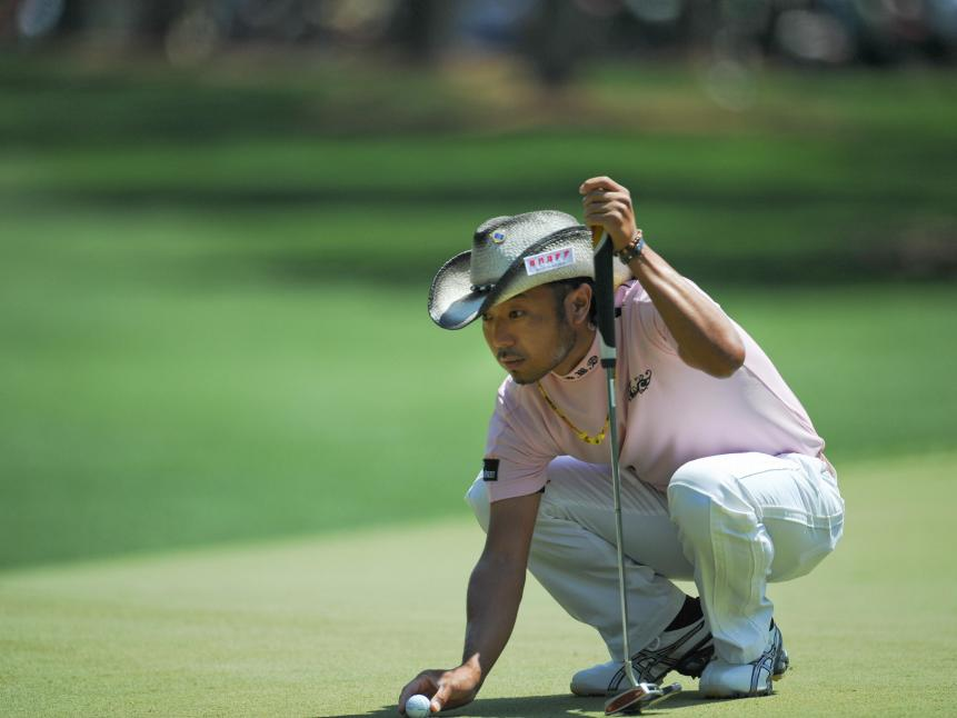 Shingo Katayama lines up a putt during t