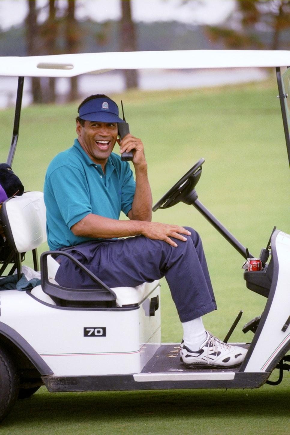 O.J. Simpson keeps in touch in his golf cart.
