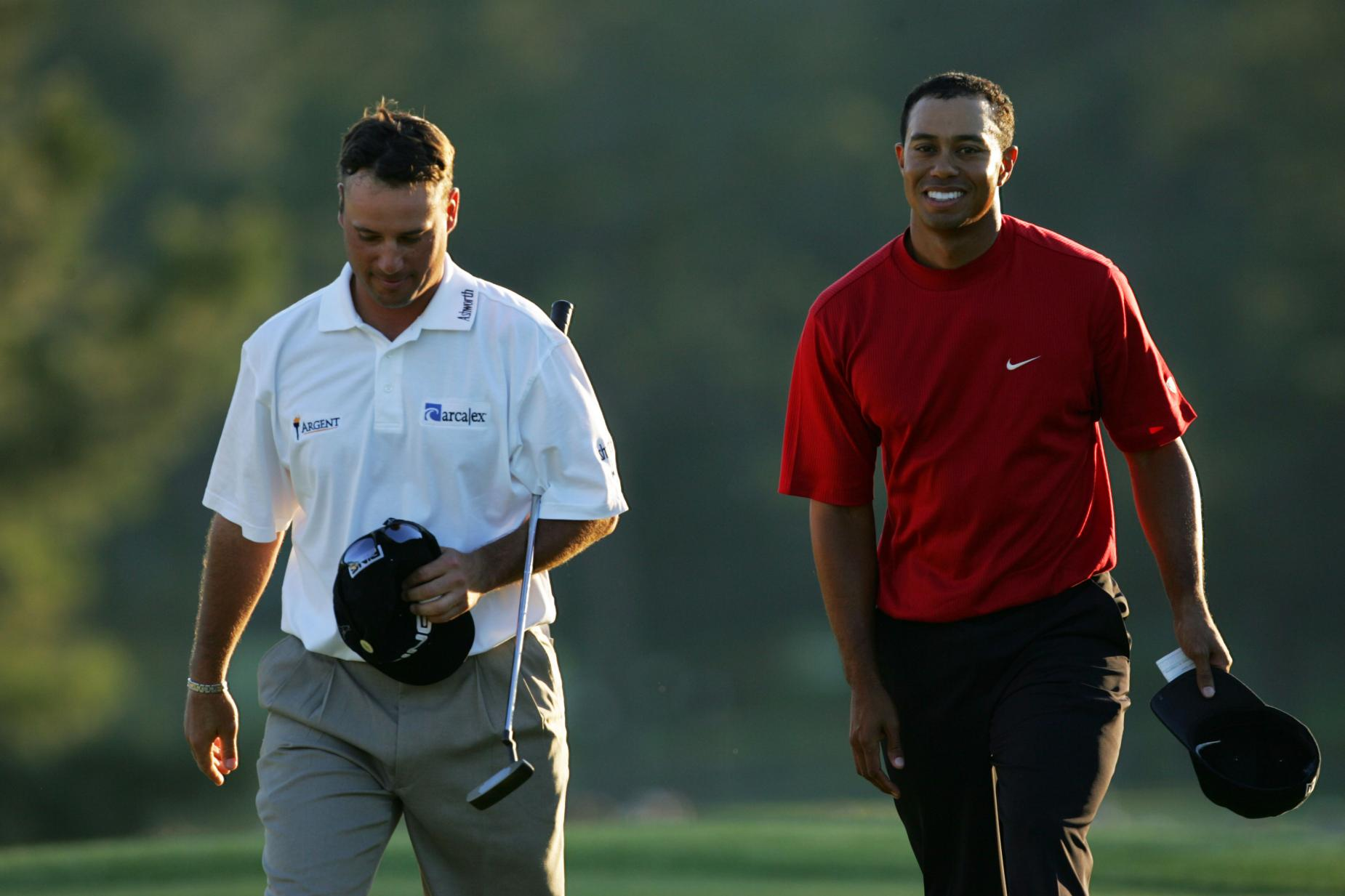 tiger-woods-2005-masters-walking-off-chris-dimarco.jpg