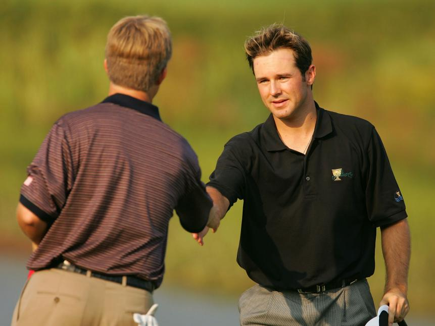 trevor-immelman-presidents-cup-2005-david-toms.jpg
