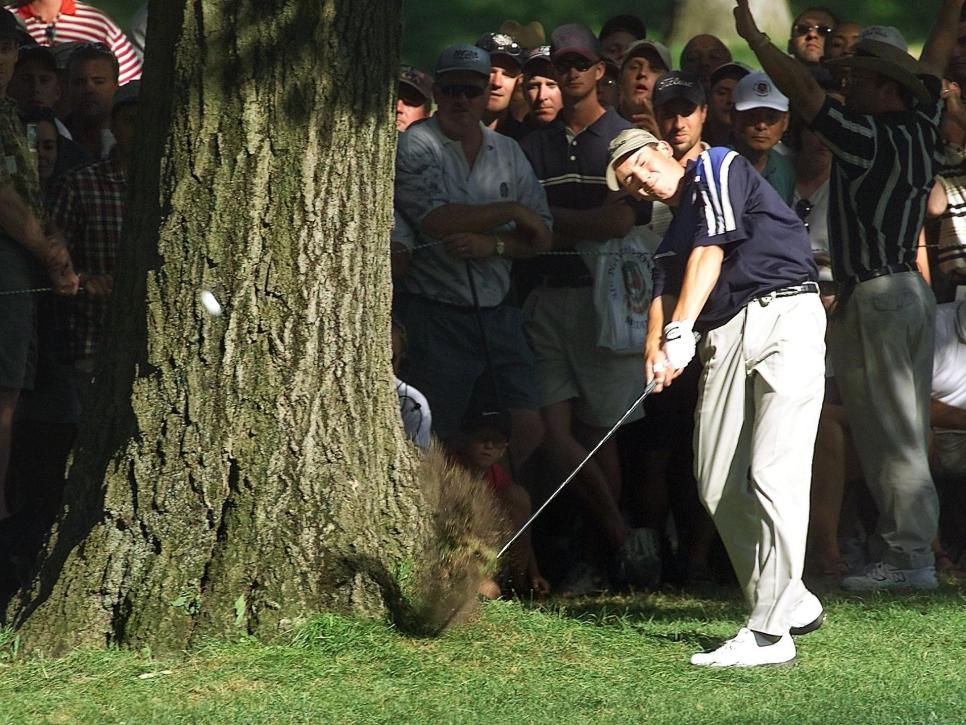 Sergio Garcia of Spain hits past a tree on the 16t