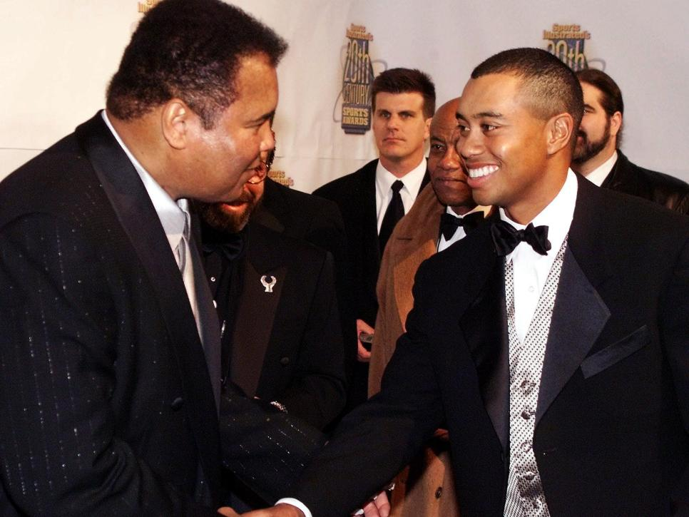 Boxing great Muhammad Ali shakes hands with golfer