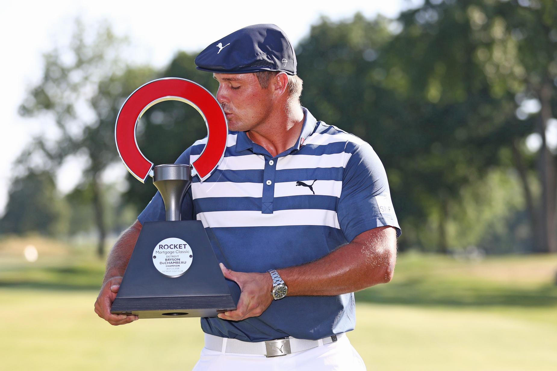 Bryson DeChambeau with the Rocket Mortgage trophy