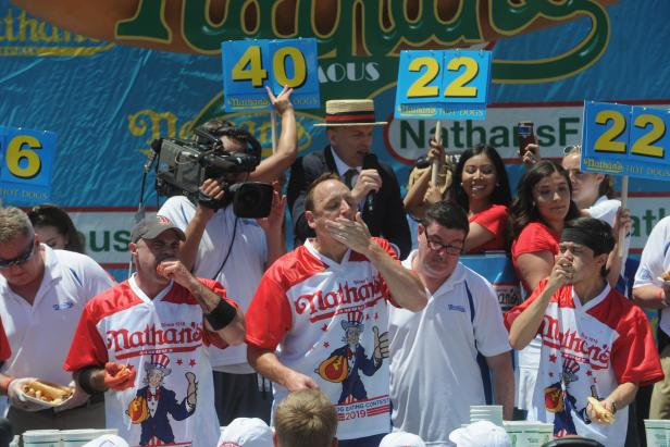 Rejoice, the Nathan's Famous Hot Dog Eating contest is still happening. Here are the facts