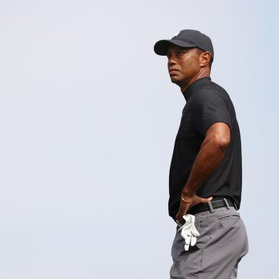 Tiger Woods is done in by historic par-5 stumbles, shoots opening 76 in title defense