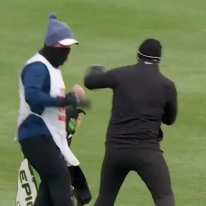 Watch a European Tour pro and his caddie put on a mid-round boxing exhibition