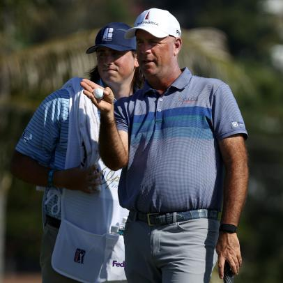 Stewart Cink with his son on the bag isn't a novelty match anymore